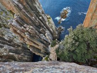 Cape Hauy cliffs in Tasmania with the Candlestick and the Totem Pole. Фото  Gudella - Depositphotos