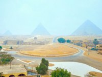 Египет. Пирамиды Гизы. Foggy panorama of Pyramids and Sphinx in Giza Necropolis, located among the desert sands, this unique site attracts, Egypt. Фото efesenk