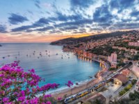Лазурный берег Франции. Вильфранш. Aerial view of Villefranche-sur-Mer and the bay of Villefranche on sunset, Alpes-Maritimes, France. Фото bbsferrari-Deposit