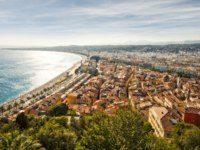 Beach of the Mediterranean sea, Cote d Azur, Nice, France. Nice is the capital of the Alpes Maritimes departement. Фото nevskyphoto - Depositphotos