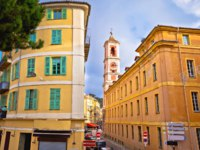 Nice colorful street architecture and church view, tourist destination of French riviera, Alpes Maritimes depatment of France. Фото xbrchx - Depositphotos