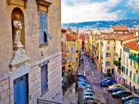 Town of Nice colorful street architecture and church view, tourist destination of French riviera, Alpes Maritimes depatment of France. Фото xbrchx - Depositphotos