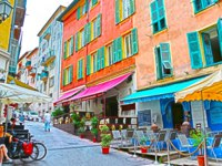 Лазурный Берег Франции. Ницца. Traditional mediterranean houses, shops and cafes in the old town in Nice, France. Фото luziana - Depositphotos