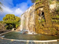 The waterfall Cascade Du Casteu at the park in Nice, tourist landmark of French riviera, Alpes Maritimes department of France. Фото xbrchx - Depositphotos