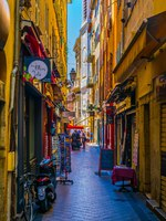Лазурный Берег Франции. Ницца. People are strolling through a narrow street in the center of Nice, France. Фото Dudlajzov - Depositphotos