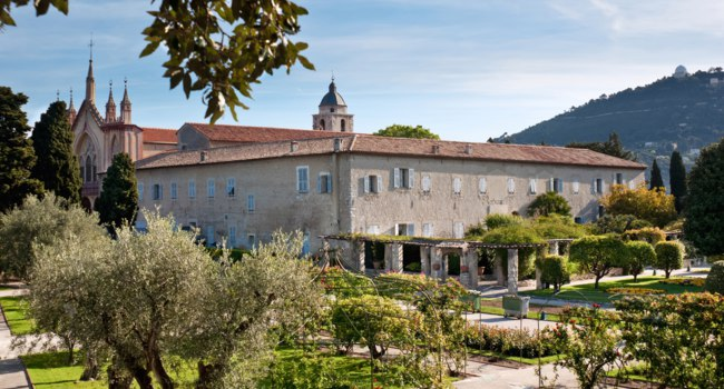 Monastery of Our Lady of Cimiez is surrounded by great garden with old olive trees and variety of rose bushes, Nice, France. Фото efesenko - Depositphotos