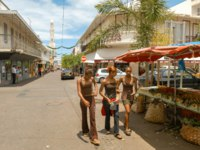 Остров Реюньон. people walking on the pedestrian street in the center of Saint Denis in Reunion island on France. Фото Fotoember - Depositphotos