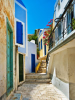 Клуб путешествий Павла Аксенова. Греция. Остров Санторини. Pretty colored streets of greek islands. Фото Maugli - Depositphotos