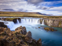 Клуб путешествий Павла Аксенова. Исландия. Long exposure image of Godafoss waterfall in Iceland. Фото alexeys - Depositphotos