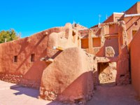 The ancient buildings of historic mountain village of Abyaneh, famous for its traditional adobe architecture, Iran. Фото efesenko - Depositphotos