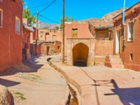 Walk the old street of Abyaneh and explore the arched exterior of preserved medieval qanat-the underground water well with long tunnel, Iran. Фото efesenko-Deposit