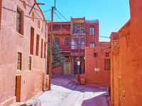 The central street of historic red-ochre village, famous for its traditional architecture and preserved authenticity, Abyaneh, Iran. Фото efesenko - Depositphotos