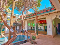 The old grape vines in courtyard of Jameh Mosque, decorated with religious inscriptions on Ashura flags and banners in Abyaneh. Фото efesenko - Depositphotos