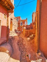 The bad earthen road with natural gutter, created by water streams, falling down during the rains and melting snows, Abyaneh village, Iran. Фото efesenko-Deposit
