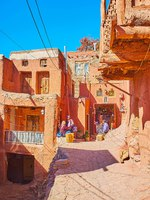 The small food store and tourist cafe in backstreet, lined with ancient adobe houses, covered with red-ochre mud in Abyaneh. Фото efesenko - Depositphotos