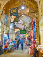 Иран. Большой базар Исфахана. Get lost in maze of narrw brick alleyways of historic Grand Bazaar interesting stalls, workshops in Isfahan. Фото efesenko-Deposit