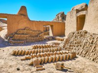 The restoration department of Rayen citadel produces the mud bricks for the needs of ancient archaeological site, Iran. Фото efesenko - Depositphotos