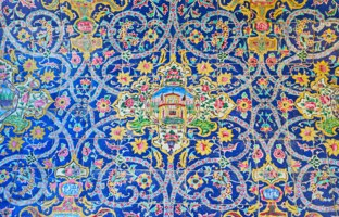 Иран. Исфахан. Мечеть Сейед. The bright wall decoration of Seyed Mosque is made of ceramic tile with ornate floral patterns in Isfahan. Фото efesenko - Depositphotos