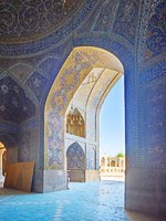 Иран. Исфахан. Мечеть Сейед. The prayer hall of Seyed Mosque is connected with its courtyard with large richly decorated arch in Isfahan. Фото efesenko - Depositphotos