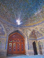 Иран. Исфахан. Мечеть Сейед. Interior of Seyed Mosque with stained-glass door, Persian screen, providing on walls and dome in Isfahan. Фото efesenko - Deposit