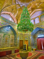 Иран. Исфахан. Мечеть Сейед. Mohammad Bagher Shafti Mausoleum of Seyed Mosque is decorated with vintage glass chandelier in Isfahan. Фото efesenko - Deposit