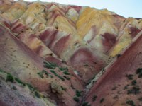 Иран. Тебризские горы. Stunning unusual colored mountains in Iran near Tabriz. Unusual geology with colorful sand in the hills. Фото Milva_El - Depositphotos