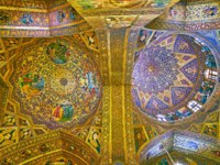Иран. Исфахан. Ванкский собор. The carved domes of Holy Savior Cathedral with rich golden decors, angels and icons in medallions in Isfahan. Фото efesenko-Deposit
