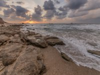 Израиль. Ашкелон. Sunset on the Mediterranean Sea. Israel, the shore of Ashkelon. Фото yuridondish@hotmail.com-Depositphotos