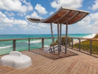 Израиль. Ашкелон. Wooden viewpoint overlooking Mediterranean sea under blue sky with white clouds in Ashkelon, Israel. Фото rglinsky-Depositphotos