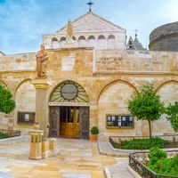 Израиль. Вифлеем. The view on the main entrance to the St. Catherine Church from the courtyard of the Church of the Nativity, Bethlehem. Фото efesenko-Depositphoto