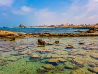 Израиль. Археологический парк Кесария. Ruins of the ancient port of Caesarea. Flooded in the sea remains of fortifications. Israel. Фото kavramm-Depositphot