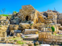 Израиль. Археологический парк Кесария. The Roman Period stone ruins, public buildings and city streets in Caesaria Maritima, Israel. Фото efesenko-Deposit