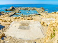 Израиль. Археологический парк Кесария. The ruins of the ancient building are partly flooded in the sea, preserved on shore, Caesaria, Israel. Фото efesenko-Deposit