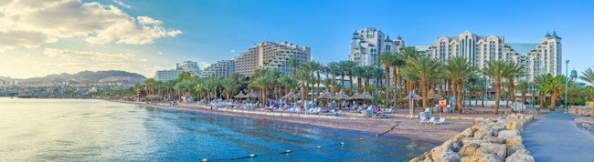 Израиль. Эйлат. Eilat is the scenic and luxury Israeli resort, located in Aqaba Gulf of the Red Sea with Jordanian Aqaba and Egyptian Taba. Фото efesenko-Deposit