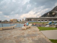 Израиль. Хайфа. Sunset beach scene with locals, boats, the Bat-Galim beach promenade and the Allenby Interchange, in Haifa, Israel. Фото RnDmS-Depositphotos