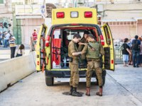 Ambulance emergency car with Israel army paramedics by the Cave of the Patriarchs in Hebron on the Sukkot. Фото R_Yanushevsky-Depositphotos