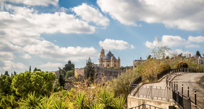 The Dormition Abbey, Catholic church, Benedictine monastery, view from the walls of the Old City of Jerusalem, Israel. Фото alefbet - Depositphotos