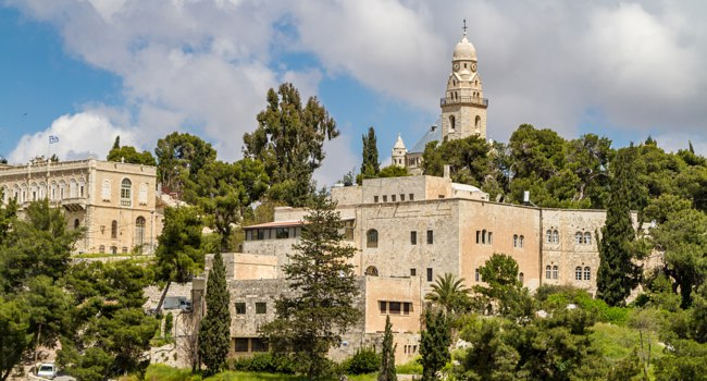 View of the Dormition Abbey and the Institute for the Study of the Bible, outside the walls of the Old City in Jerusalem, Israel. Фото alefbet - Depositphotos