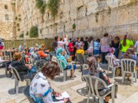 Израиль. Иерусалим. Women praying their wishes at the Western Wall, Wailing Wall or Kotel of the western side of the Temple Mount. Фото dbajurin-Deposit