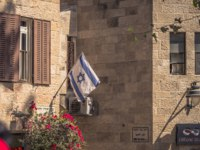 Израиль. Иерусалим. Israeli flag in the Old City of Jerusalem, Israel. Фото RPBMedia - Depositphotos