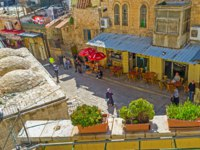 Израиль. Иерусалим. Виа Долороза. View on cozy cafes of Via Dolorosa street from the terrace of Austrian Hospice in Jerusalem. Фото efesenko-Depositphotos