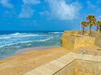 Израиль. Акко. The sea walls nowadays serve only as the landmark, decorating the beach line, Acre, Israel. Фото efesenko - Depositphotos