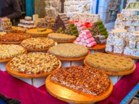 Израиль. Акко. The gozinaki, made of nuts, colorful lokum and sweet halva in the stall of the Turkish Bazaar, Acre, Israel. Фото efesenko - Depo