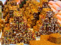 Клуб путешествий Павла Аксенова. Израиль. Акко. Various sweets on sale in the market of the old city, in Acre, Israel. Фото RnDmS - Depositphotos