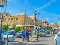 Израиль. Акко. The narrow streets of the old Akko are always full of cars, bikes, pedestrian tourists and local merchants. Фото efesenko - Depositphotos