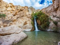 Израиль. Национальный природный парк Эйн-Геди. Charming small falls among stones of the dried-up desert. The journey through the national park and reserves Ein
