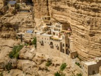 The Wadi Qelt or Nahal Prat, the Greek Orthodox monastery of Saint George of Choziba in Judaean Desert near Jericho, Israel. Фото alefbet-Depositphotos