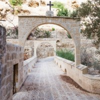 Gates-entrance to the monastery of St. George Hosevit (Mar Jaris) standing near Mitzpe Yeriho in Israel. Фото svarshik1.gmail.com-Depositphotos