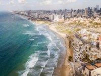 Израиль. Панорама Тель-Авива. Aerial view of big city with sandy seashore and wavy sea, Tel Aviv, Israel. Фото VeronikaGorBO-Depositphotos
