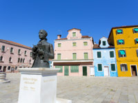 Central square and monument Baldassare Galuppi, byname Il Buranello on the famous island Burano. Фото lachris77 - Depositphotos